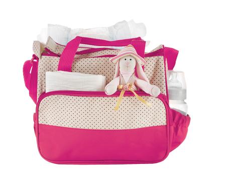 Foto de Mothers bag with toy and accessories on white background - Imagen libre de derechos