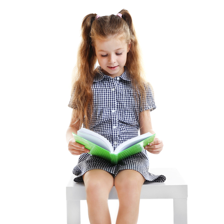Photo pour Cute girl reading book on white background - image libre de droit