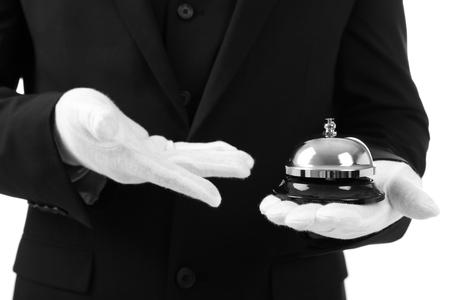 Photo pour Male waiter holding bell on white background - image libre de droit
