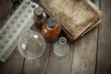 Foto de Vintage equipment of chemical laboratory on wooden background, closeup - Imagen libre de derechos
