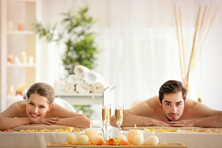 Foto de Young happy couple relaxing in spa salon - Imagen libre de derechos