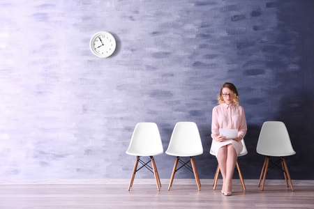 Photo for Young woman waiting for job interview in reception hall - Royalty Free Image
