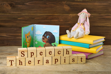 Foto de Wooden blocks with space for text on table. Concept of child's speech therapist - Imagen libre de derechos