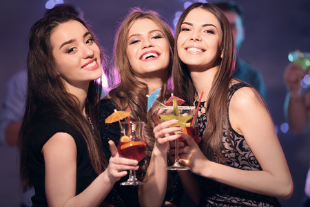 Photo for Friends with tasty cocktails at party in night club - Royalty Free Image