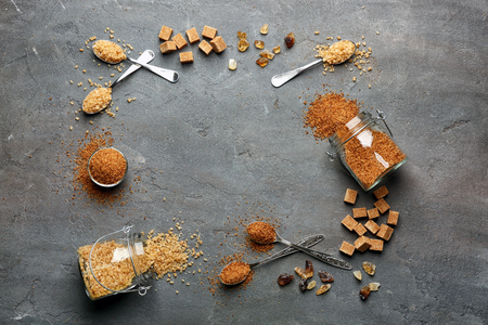 Photo for Composition with brown sugar on grey textured background - Royalty Free Image