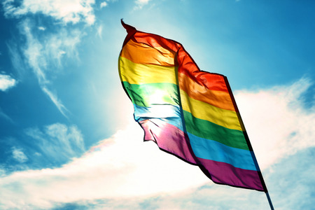 Photo for Gay flag on sky background - Royalty Free Image