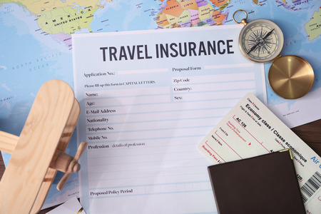 Photo pour Blank travel insurance form and map on background - image libre de droit