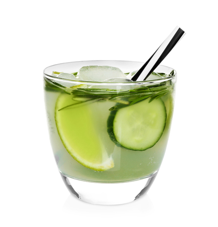 Foto de Glass with cold lemonade with cucumber and lime on white background - Imagen libre de derechos