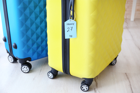 Photo for Tag on heavy suitcase. Luggage overweight concept - Royalty Free Image