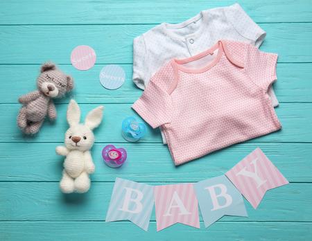 Foto de Composition with baby accessories on wooden background - Imagen libre de derechos