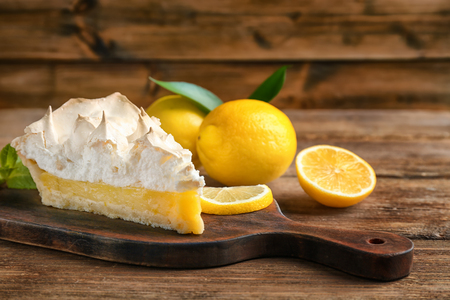 Photo for Piece of yummy lemon meringue pie on wooden table - Royalty Free Image
