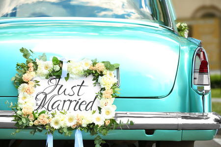 Photo for Beautiful wedding car with plate JUST MARRIED outdoors - Royalty Free Image