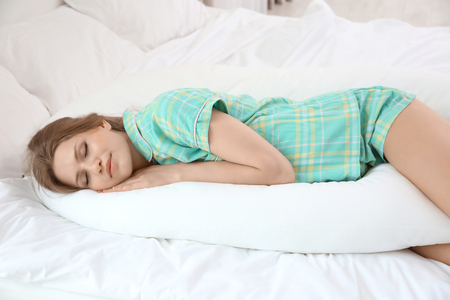 Foto de Beautiful pregnant woman sleeping with body pillow - Imagen libre de derechos