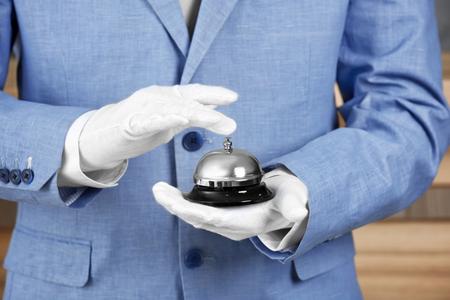 Photo pour Man with bell on blurred background, closeup - image libre de droit