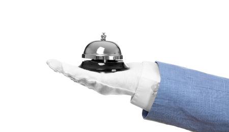 Photo pour Man holding bell on white background - image libre de droit