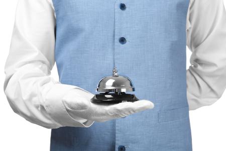 Photo pour Man holding bell on white background, closeup - image libre de droit