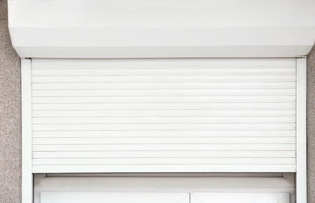 Foto de Window with half-closed roller shutter, closeup - Imagen libre de derechos
