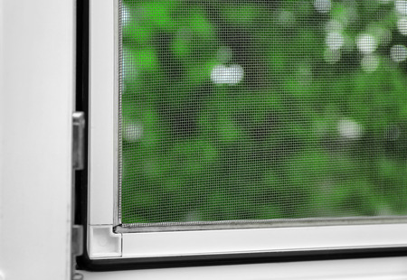Foto de Window with mosquito screen indoors - Imagen libre de derechos