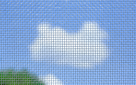 Photo pour View of sky through window screen, close up - image libre de droit