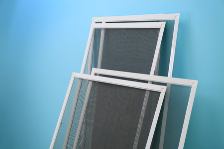 Foto de Mosquito window screens on color background - Imagen libre de derechos