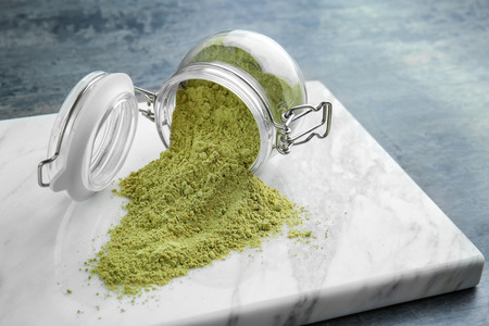 Photo pour Hemp protein powder and glass jar on board - image libre de droit