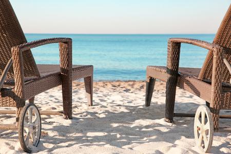 Photo for Empty sunbeds on beach near sea - Royalty Free Image