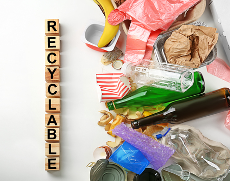 Photo pour Composition with garbage and word Recyclable on white background - image libre de droit