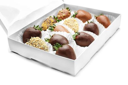Foto de Box with tasty chocolate dipped strawberries on white background - Imagen libre de derechos