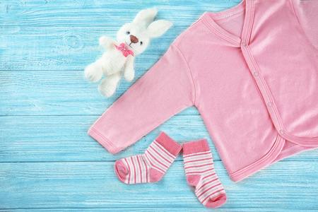 Foto für Baby's first cloth on wooden background - Lizenzfreies Bild