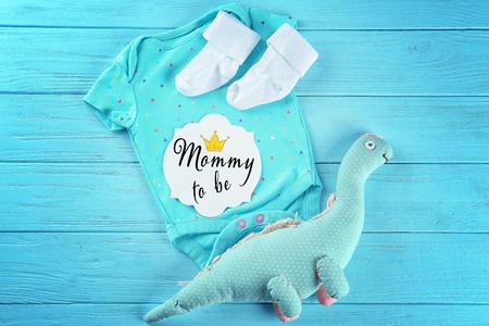 Foto für Baby's first cloth on color background - Lizenzfreies Bild