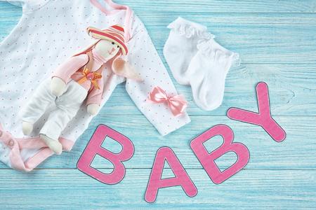 Foto für Composition with baby's first cloth on wooden background - Lizenzfreies Bild