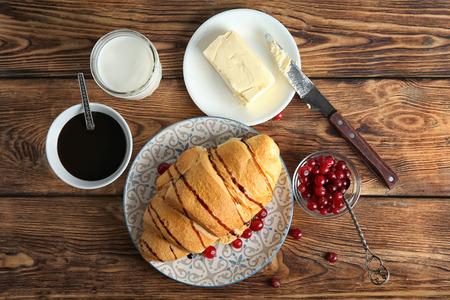 Photo pour Composition with yummy fresh croissant on wooden table - image libre de droit