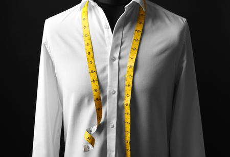 Photo for Elegant custom made shirt on mannequin against black background, closeup - Royalty Free Image