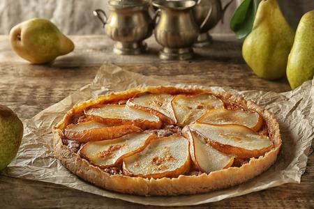 Photo pour Delicious pear tart on table - image libre de droit