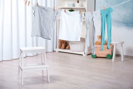 Photo pour Clothes hanging on laundry line indoors - image libre de droit