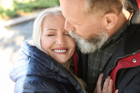 Foto per Happy mature couple outdoors - Immagine Royalty Free