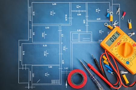 Photo pour Flat lay composition with electrical tools on house plan - image libre de droit