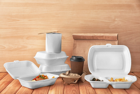 Photo pour Containers with delicious food and cup of coffee on wooden table - image libre de droit