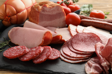 Photo for Assortment of delicious deli meats on slate plate - Royalty Free Image