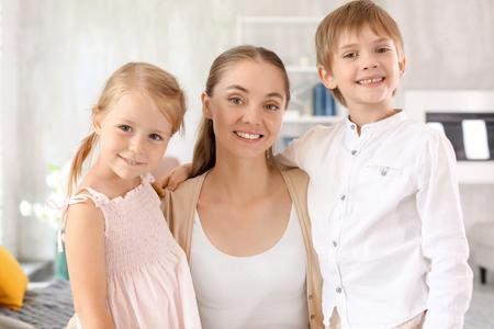 Photo pour Cute little kids with their mother at home - image libre de droit