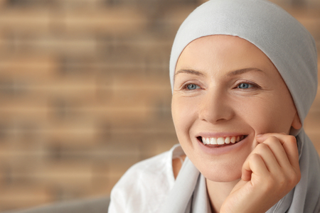 Photo for Portrait of happy woman after chemotherapy on blurred background - Royalty Free Image