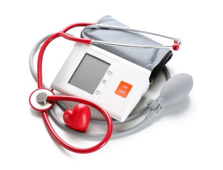 Foto de Sphygmomanometer with red heart and stethoscope on white background - Imagen libre de derechos