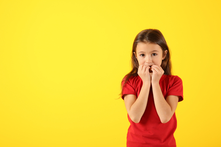Photo for Emotional girl after making mistake on color background - Royalty Free Image