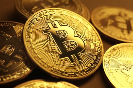 Photo pour Golden bitcoins on table, closeup - image libre de droit