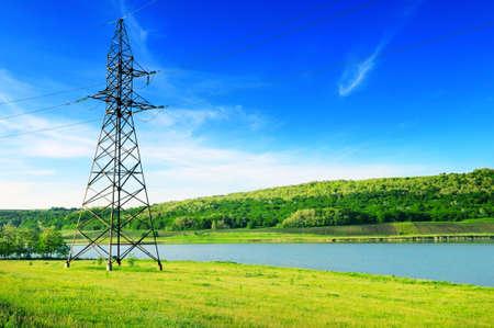 Foto de High-voltage power line on the shore of the lake.                                     - Imagen libre de derechos