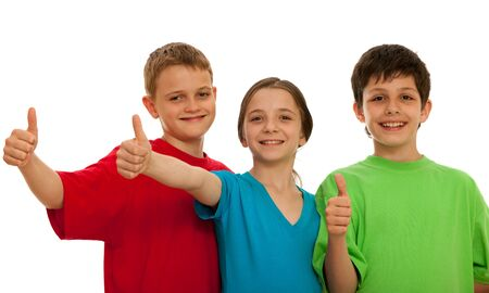 Three happy kids are holding their thumbs up; isolated on the white background