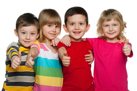 Four children are standing together; isolated on the white background