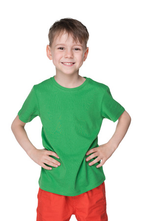 Photo for A portrait of a handsome little boy in a green shirt against the white background - Royalty Free Image