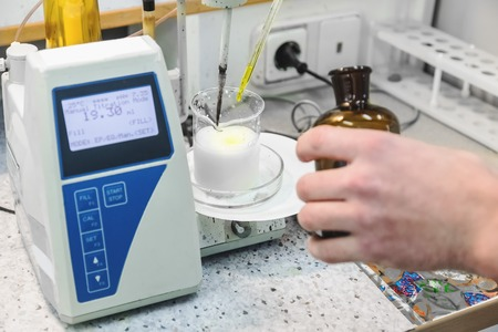 Foto de Laborant makes test in research laboratory with electronic measuring equipment on pharmaceutical industry manufacture or chemical plant - Imagen libre de derechos