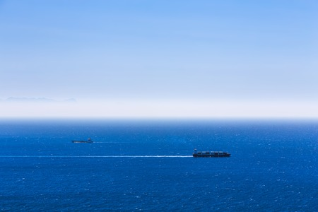Photo for Cargo ships with containers in the open Atlantic ocean - Royalty Free Image